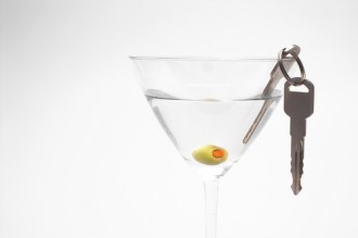 martini glass with car keys in it, indicating you shouldn't drink and drive.